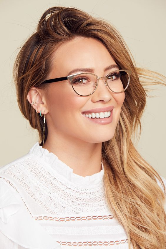 Hilary Duff wearing polished nude and black glasses for a super elegant and chic look
