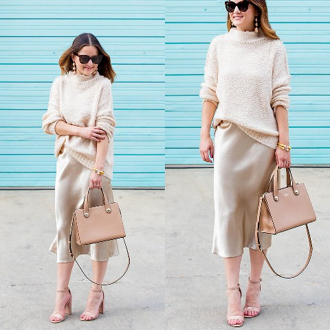 With beige loose sweater, beige leather bag and beige ankle strap high heels