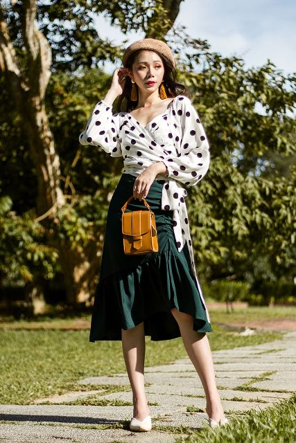 With beret, emerald ruffled skirt, brown bag and white mules