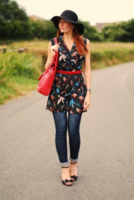 With black hat, red leather bag, cuffed jeans and black ankle strap shoes