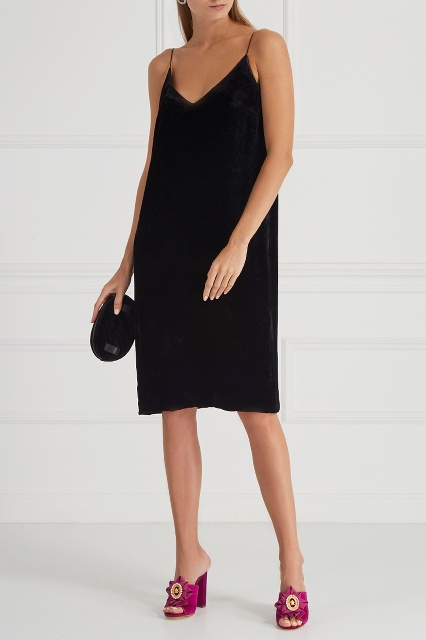 With black knee-length dress and black clutch