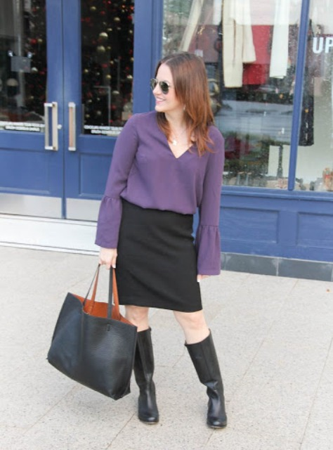 With black knee-length skirt, black leather tote bag and black high boots