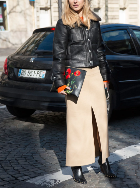 With black leather jacket, floral printed clutch and black embellished boots