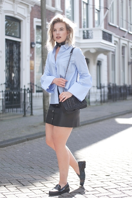 With black leather mini skirt, chain strap bag and flat shoes