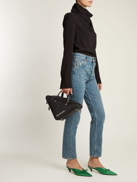With black long sleeve shirt, jeans and black triangle bag