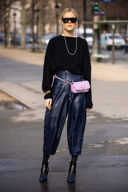 With black long sleeved sweater, leather culottes and black and blue shoes