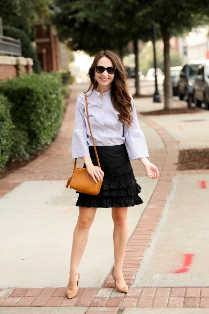 With black ruffled mini skirt, brown tassel bag and beige pumps