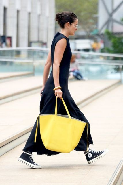 With black sleeveless maxi dress and black and white sneakers