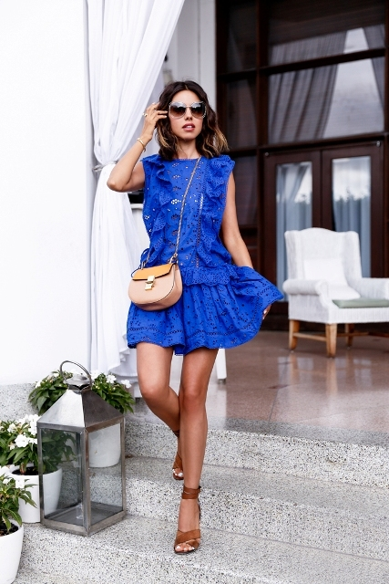 With blue lace ruffled mini dress and brown ankle strap shoes