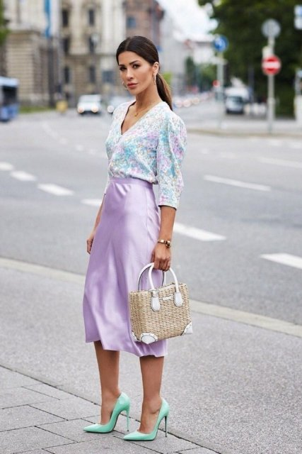 With colorful blouse, straw bag and mint green pumps