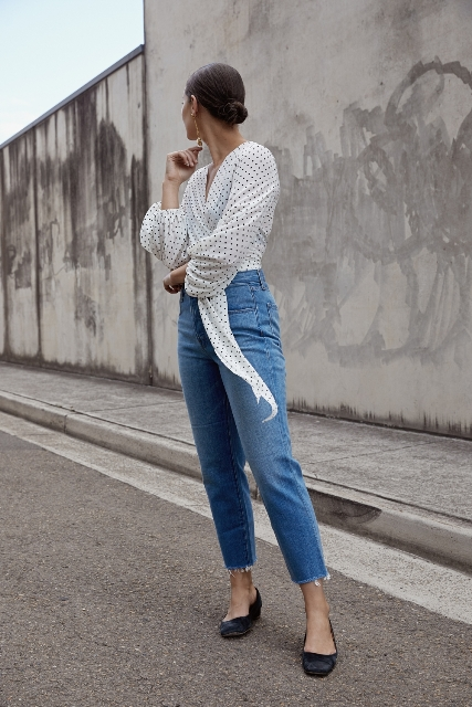 With cropped jeans and black flat shoes