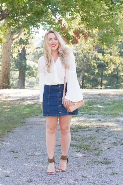 With denim button front mini skirt, pale pink bag and brown fringe sandals