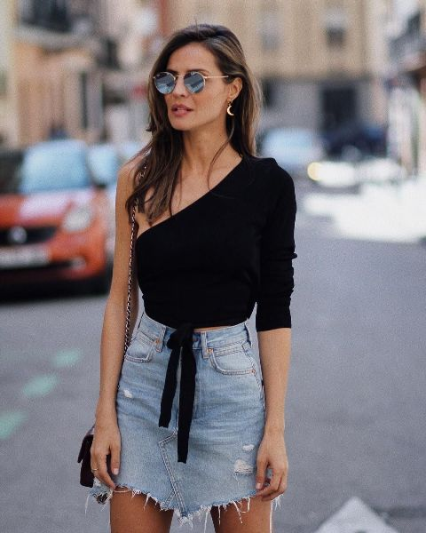 With denim distressed mini skirt and chain strap bag