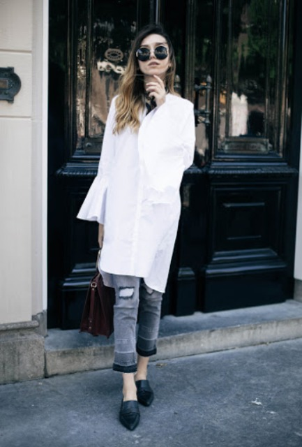 With distressed crop jeans, bag and black flat shoes
