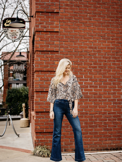 With flare jeans and boots