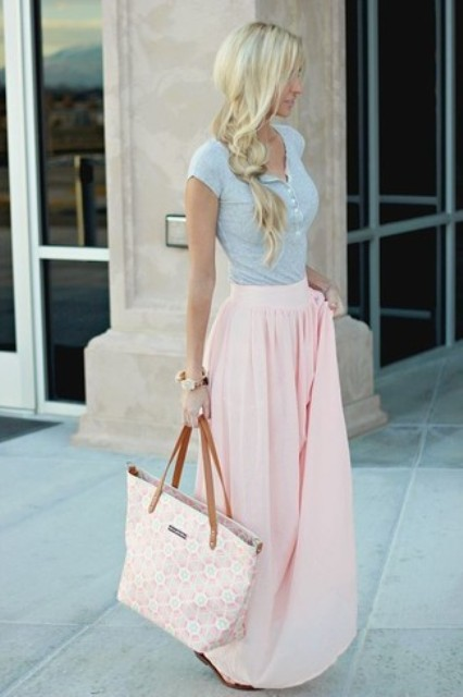 With gray t-shirt and pale pink maxi skirt