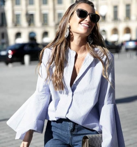With jeans and printed clutch