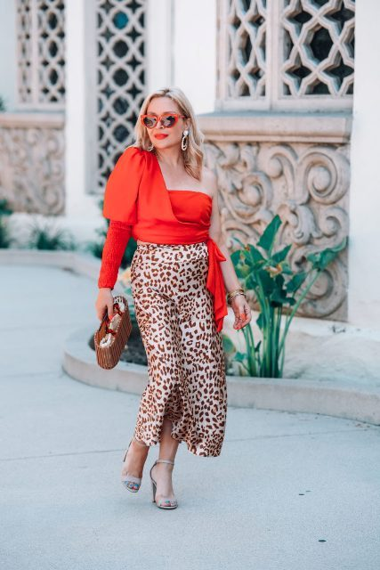 With leopard printed midi skirt, beige shoes and straw bag
