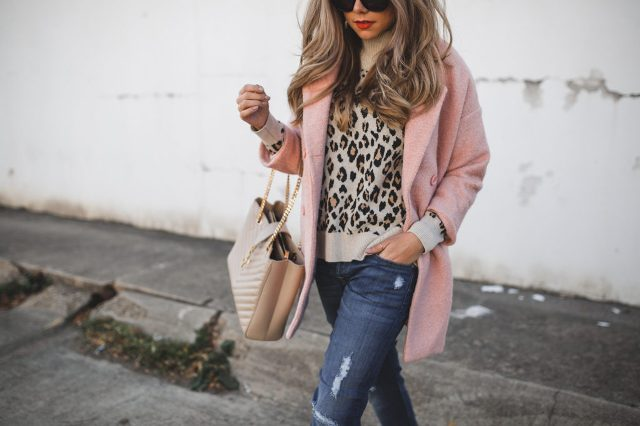 With leopard printed shirt, distressed jeans and pale pink coat