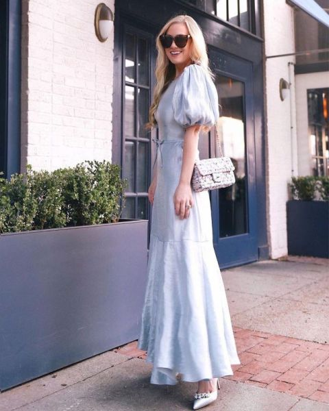 With light blue maxi dress and chain strap bag