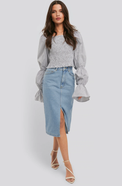 With light gray long sleeved blouse and beige lace up shoes