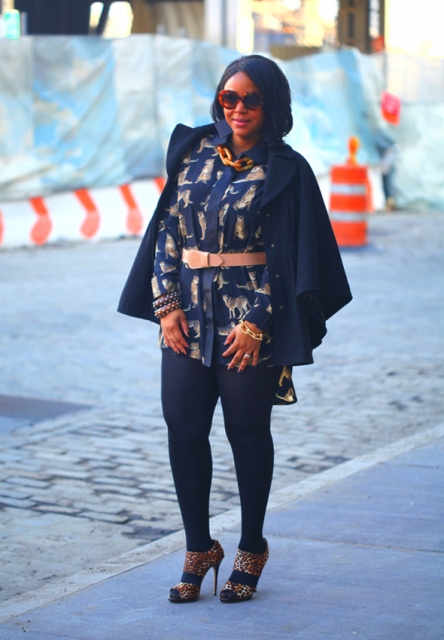 With navy blue coat, leggings and leopard printed shoes