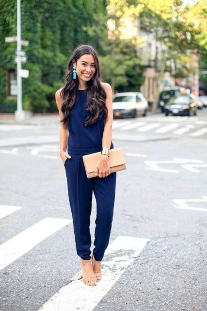 With navy blue top, navy blue loose pants and beige shoes