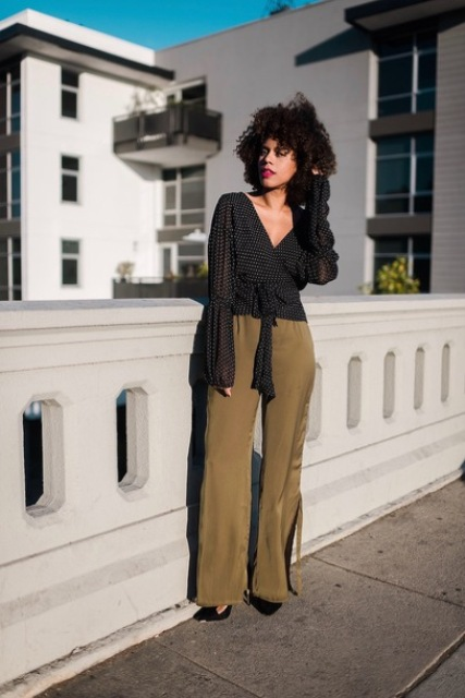 With olive green palazzo pants and black pumps