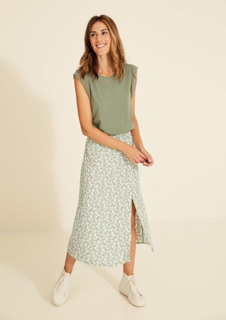 With olive green shirt and beige lace up flat shoes