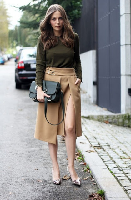 With olive green shirt, leather bag and printed pumps