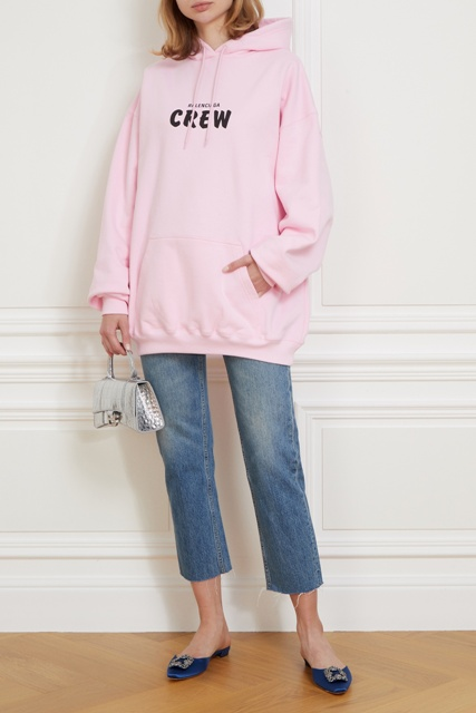With pale pink labeled hoodie, silver mini bag and cropped jeans