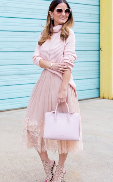 With pale pink sweater, lace midi skirt and lace up high heels