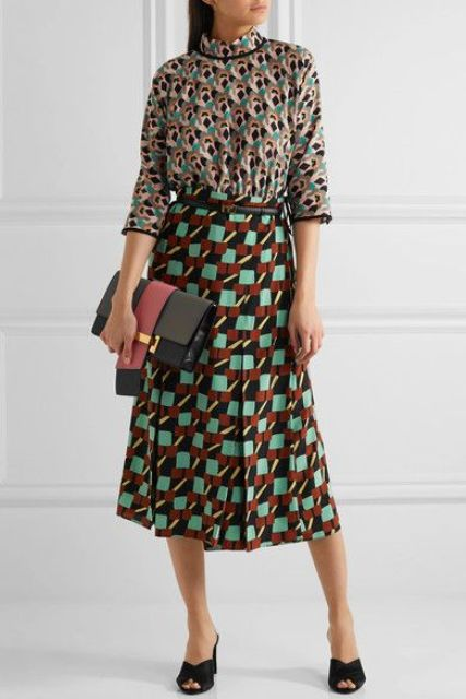 With printed blouse, printed midi skirt and two colored clutch