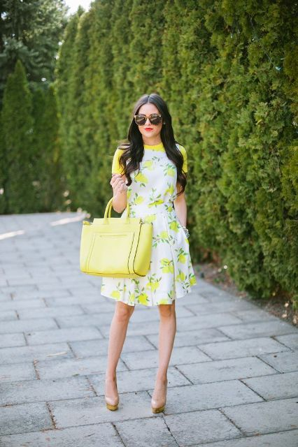 With printed knee-length dress and beige platform shoes