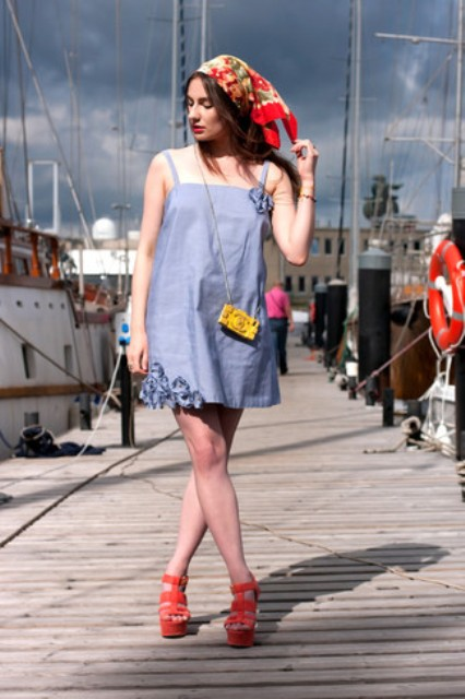 With printed scarf, light blue mini dress and red platform sandals