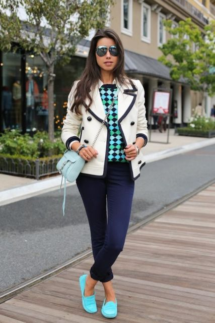 With printed shirt, black and white jacket, navy blue jeans and flat shoes