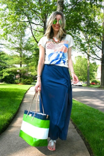 With printed t-shirt, blue maxi skirt and white flat sandals