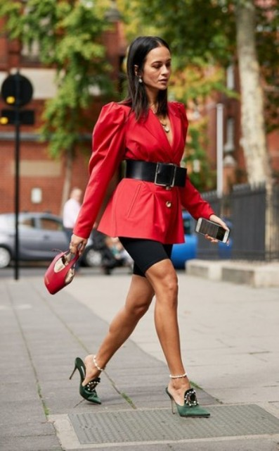 With red long blazer, black belt, black shorts and red bag