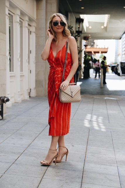 With red striped midi dress and beige ankle strap high heels