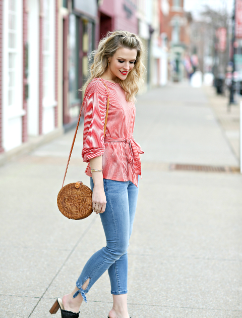 With skinny cropped jeans, straw rounded bag and black heeled mules