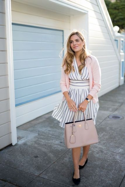 With striped dress, pale pink cardigan and black flat shoes