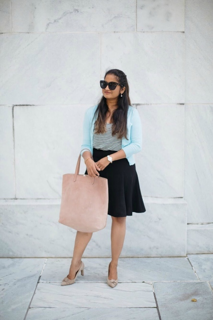 With striped top, light blue cardigan, black skater skirt and beige shoes