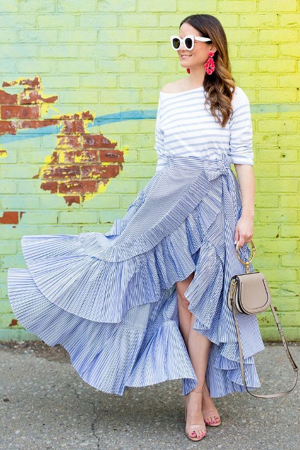 With white and light blue striped shirt, beige bag and beige ankle strap shoes