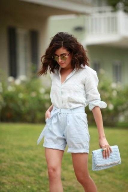 With white button down shirt and light blue belted shorts