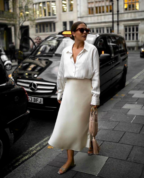 With white button down shirt, bag and flat sandals