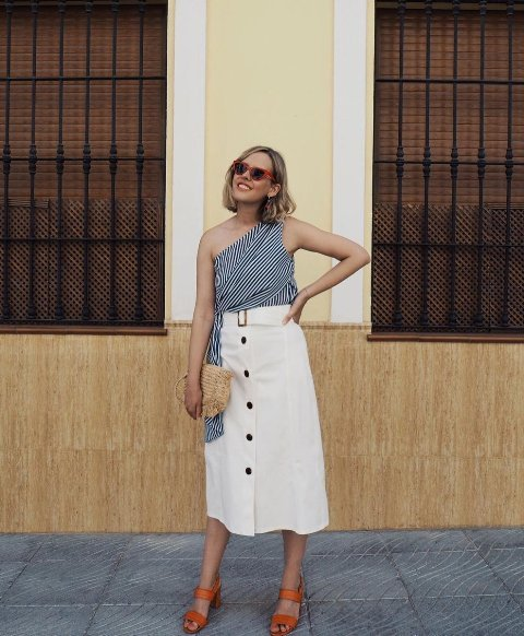 With white button front midi skirt, straw bag and brown leather sandals