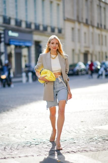 With white crop top, gray long blazer, denim shorts and sandals