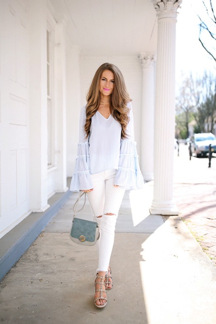 With white distressed pants, two colored bag and lace up shoes