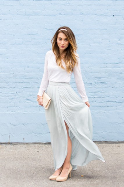 With white long sleeved shirt, beige pumps and beige clutch