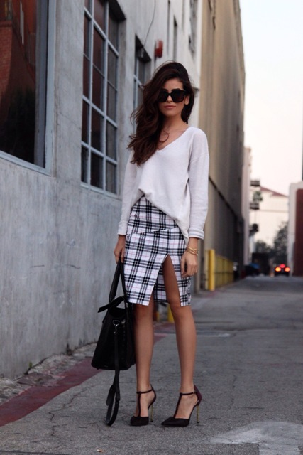 With white loose shirt, black bag and high heels